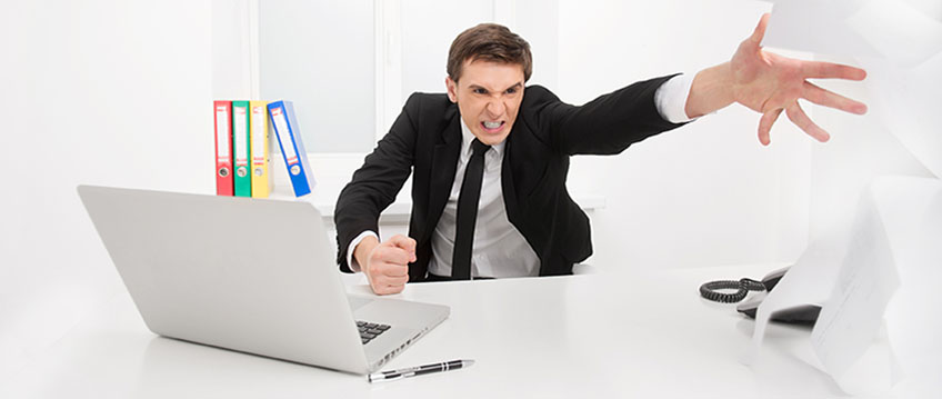 image of man throwing papers across desk